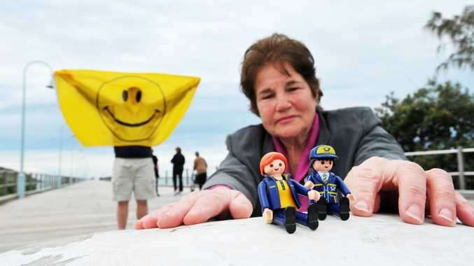 Postcrossing enthusiast Glennis Tracey with the mascots of the postcard phenomenon, who are going on a tour of Coffs Harbour.
