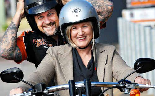 Autism Queensland chief executive officer Penny Beetson takes Mackay Motorcycles principal dealer Peter Baldwin for a spin after the business donated $3000 to the new autism early intervention centre in Mackay.
