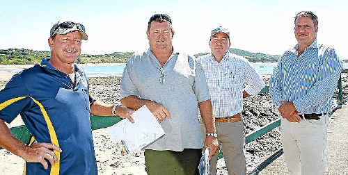 Clive King, left, with John Reed, LNP Candidate Bruce Young and Cr Brett Svendsen meet to discuss the redevelopment of the Emu Park boat ramp at Fisherman's Beach.