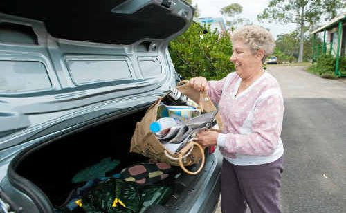 Dot Brown loads recyclables into her car to take to a friend's place, but says other caravan park residents do not have cars and have no opportunity to recycle.