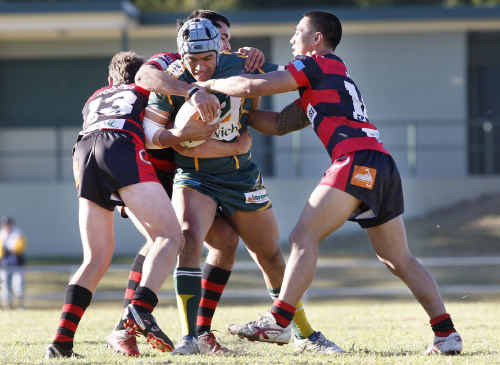 Ipswich Jets colts player James Tuiluga shows his strength in his team's 50-6 victory over Wests last weekend.