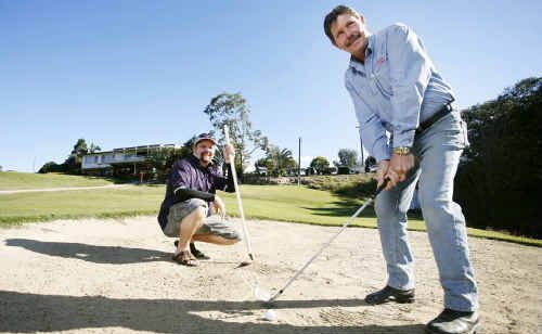Sandy Gallop club captain Rod Daniels (right) works on his game watched by vice-president John Brady.