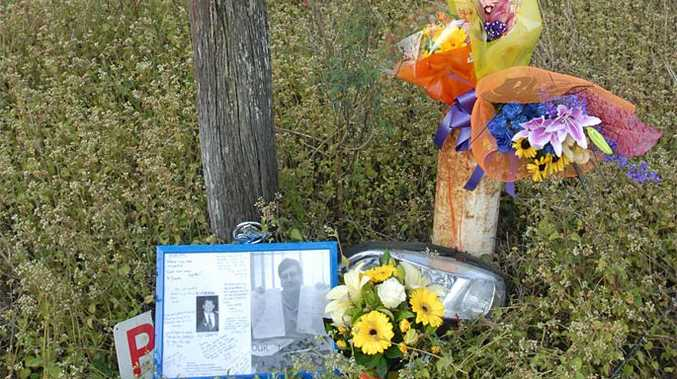 Photos, flowers and loving messages for a tribute at the scene of the crash.