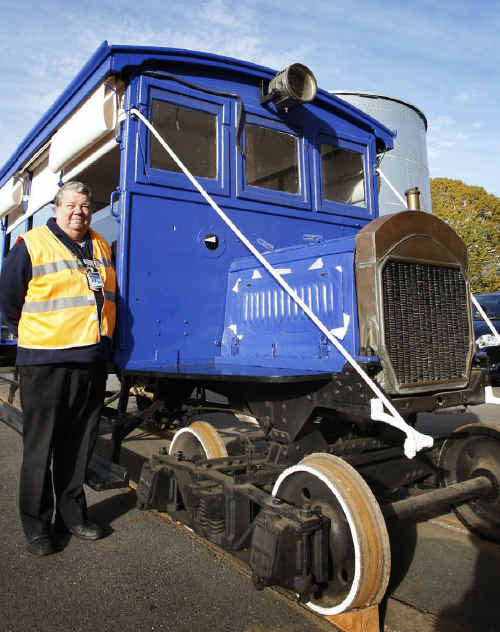 Workshops Rail Museum curator David Mewes with the 93-year-old railmotor that is leaving for a trip to north Queensland.