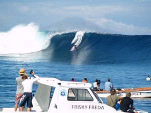 Surfers take on monster Fiji waves