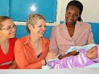 Midwives Natarsha Jazepczyk (left) and Vicki Chan with mother Dorothy and her new baby Amos at the Fremo Medical Clinic in Nairobi.