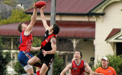 Alex Cutmore contests the ball at the centre bounce for the Redbacks.