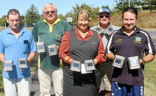 Emu Park Bowls Club president Rob Dunn, Bell Park Caravan Park's Jim Waterman, Bendigo Bank's Denise Weisse, visitor Ian Brown and Emus Beach Resort owner Paul Neubecker have taken it upon themselves to buy solar lights to be installed along the Pattison St footpath in Emu Park.
