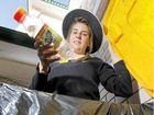 Storm Gribble, environmental committee prefect at Girls Grammar bins a bottle.