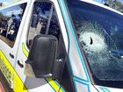 A paramedic escaped serious injury when a piece of wood smashed through the ambulance vehicle he was driving .
