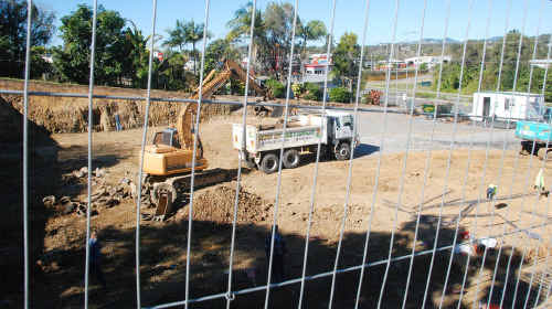 Work is powering along on foundations of the Woolworths Caltex fuel station on the Bruce Hwy through Gympie, with Coles' new project nearby (inset).