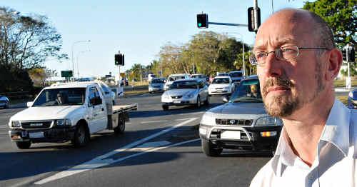 Ian Howlett keeps an eye on the traffic flow on Nebo Rd, Mackay