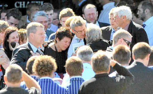 Family and friends mourn Halley Appleby at his funeral at Nambour yesterday.