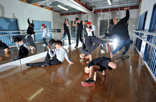 Travers Ross and a dance crew of some of Australia's leading choreographers teach local boys how to get their groove on.