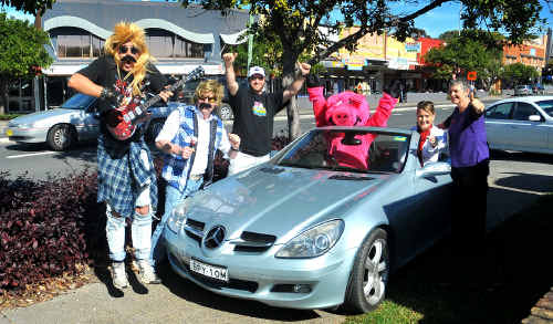 Jetty traders supporting the Rally are (from left) Scruffy Mullet (Andrew Smith), Crusty Mullet (Greg Softley), Justin Squires, Pinkie the Hog's Breath mascot, Lyn Malcolm, and Kim Towner.
