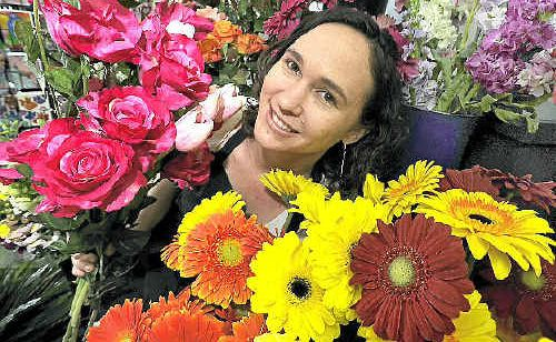 Owner Jolene Mulchay, of The Enchanted Florist in Lismore, believes that flowers increase productivity in the office.