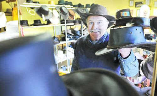 Cutana Hat Company owner Jack Cunningham with the leather old softie which was worn by the Australian gymnastic team in Switzerland.