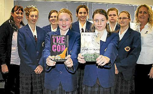 Warwick High School Year 9 pupils Sarah Kane and Emily Plant, with (back) librarian Janet Williams, Clara Maw, Maggie Hay, Lauren Drewery, Georgia Butler, Jacqui MacKinnon and English teacher Kirsty Caterson.