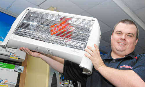 Drew Sadler, of Retravision, has seen a spike in heater sales as residents seek strive to stay warm this winter.