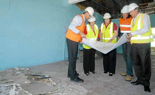 Ranbury management group's project director Marcus Frommolt (left) Cr Deirdre Comerford, Cr Di Hatfield, construction manager Graham Pellow and project manager Al Hahn look over plans for the expansion of the Hibiscus Shopping Centre at Bucasia.