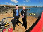 Bundaberg Port manager Jason Pascoe and Bundaberg Regional Council disaster management officer Mal Churchill look over the equipment used in a oil spill response demonstration, which is part of the major disaster conference.