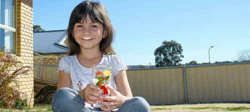 "Gracie Forbes enjoys a cool glass of milk amid what has been described as an ""unholy price war""."