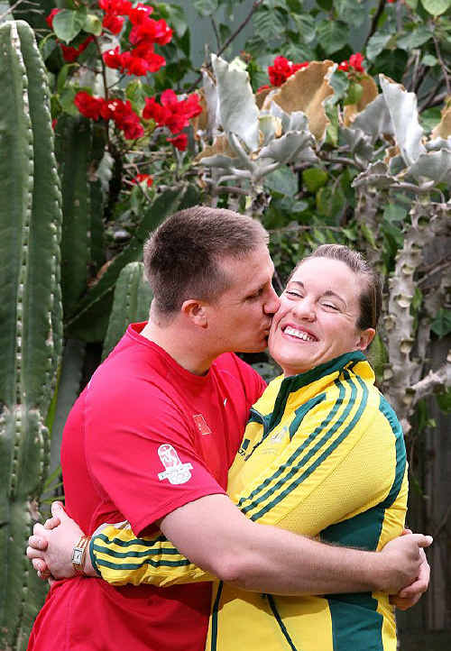 Ipswich Olympian Deborah Acason receives a kiss from husband Joshua at their Dinmore home.