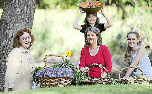 EcoMart director Effie Ablett (left) with Elke (13), and Eve (9) Howell and their mum Jenny Stonier enjoying the natural benefits of sustainable home-grown food.