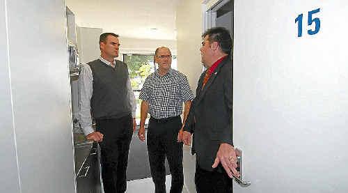 Moranbah State High School principal Jeremy Godden (left), BMC asset president Michael Rosengren and CQUniversity head of Mackay campus Pierre Viljoen inspect the Mackay student residence.