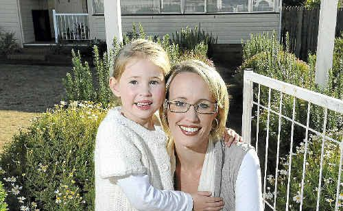 Emily Barnes cuddles up with daughter Olivia at their new family home quickly snapped up before the State Government cuts its stamp duty concession on Monday.