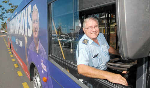 Mackay Transit bus driver David Capper behind the wheel of a bus advertising The Good Guys. The bus is one of two motoring around Mackay with full advertising wraps.