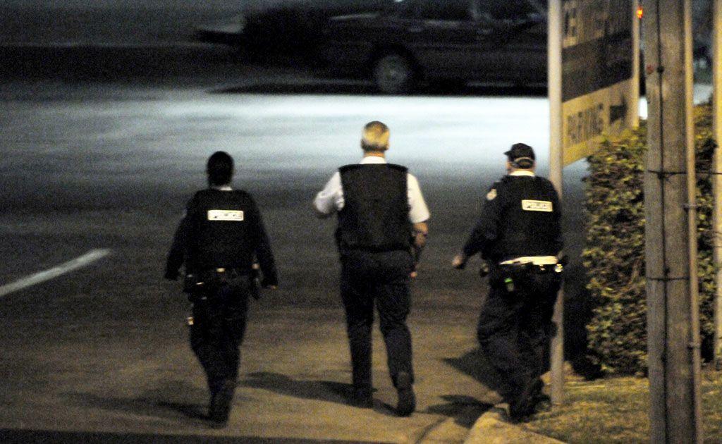 Police wearing bulletproof vests take position near BCF.