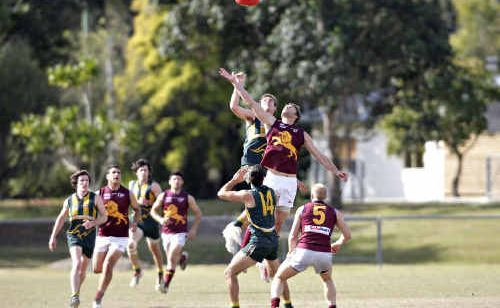 The big men fly at Maroochydore's Fishermans Road ground yesterday.