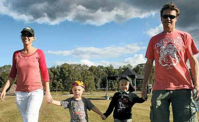 Byron Bay family Chris Moon and Mandy Montalbetti with their children Hunter, 3, and Tyler, 5, were among those to inspect progress on the sports complex on Sunday.