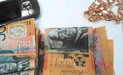 CASH, phone and jewellery seized during a search of a car at Clothiers Creek yesterday.