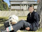 Eleanor Cullen, with her dog Samantha, says the region's new planning scheme does not do enough to protect Toowoomba's historic neighbourhoods.