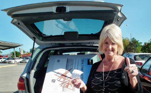 Irene Banko is delighted with the table-and-chairs set she snapped up for a bargain at Aldi in Maryborough.