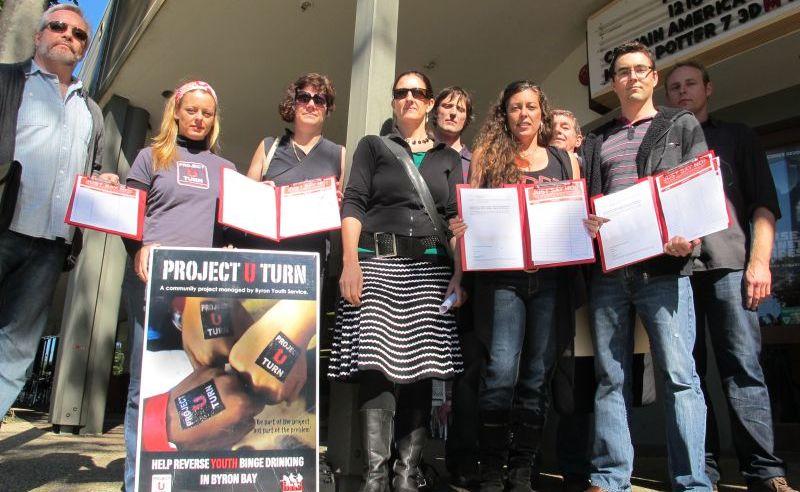 Paul Waters; Kate Reed; Neroli Jager; Di Mahoney; Mike Clark; Nicqui Yazdi; Graham Pearson; Darren Pearson and Luke Mooney display a Project U-turn poster and petitions.