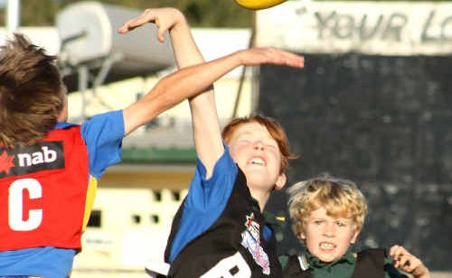 Juniors take a leap in Emerald during the AusKick coaching clinics.