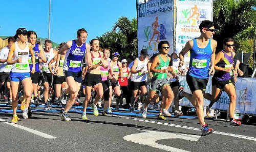 Competitors in the 15km leg of the Cane2Coral fun run take their first paces towards their end destination of Bargara.