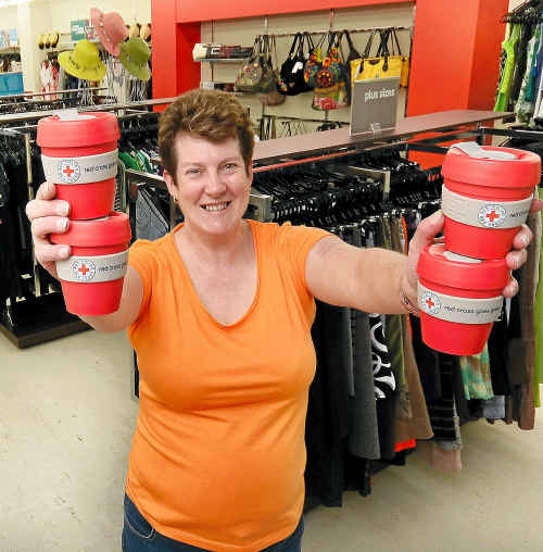 Volunteer Debra Southgate fills the new Red Cross store with stock.