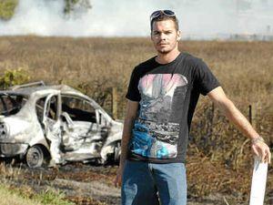 Man pulls woman from burning car
