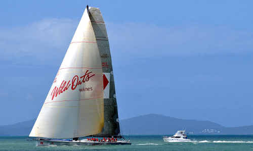 Wild Oats XI crosses the finish line of the Capricorn Coast as the winner and record-breaker of the Brisbane to Keppel Tropical Yacht race.