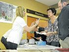 Ballot official Laureen Creevey helps Sheila and Richard Cork lodge their preferences for the Grantham land swap deal.