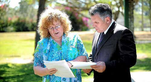 Eleonor Lambert and Member for Burnett Rob Messenger go through documentation relative to her surgery.