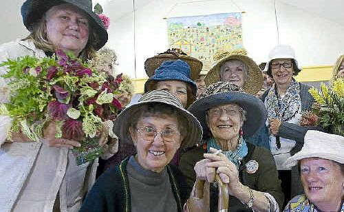 The Lismore over 50s Learning Centre members spice up the basic painting course by dressing up to honour the late Margaret Olley.