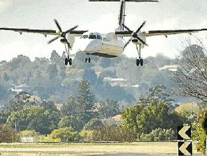 A Skytrans Dash-8 300 prepares to touch down at Toowoomba airport.