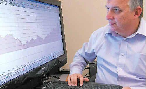 Financial planner Joe Sim, of RBS Morgans in Mackay, keeps a close eye on the stock market yesterday.