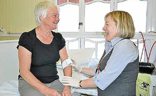 Maryvale's Julie McFetridge, with Red Cross nurse Anne-Marie Buckly, donates at a previous visit from Red Cross.
