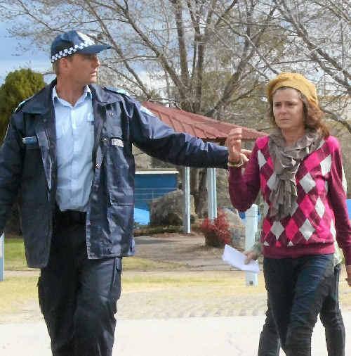 Allison Taj Frederiksen, 39, is picked up by police.
